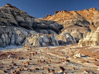 Clay And Sandstone Form A Surreal Lunar-Like Landscape With Pedestal Formations Called Hoodoos At The Bist/De-Na-Zin Wildermess in this commercial landscape photograph by Brian Buckner Photography.