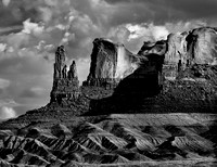 Rock Formations At The End Of A Buttressed Plateau In Utah's High Desert Look Like A Family Standing Guard In This Black And White Commercial Landscape Photograph By Brian Buckner Photography.