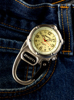 A Dakota Mini Clip Micro Light Watch is shown resting by the pocket of a pair of blue jeans advertising it's use in this commercial product advertising photograph by Brian Buckner Photography.