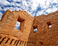 Three windows at Pueblo Bonito Indian Ruin at Chaco Canyon under a blue sky in this commercial architectural photograph by brian buckner photography, shreveport, louisiana.