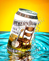 A can of Southern Drawl beer produced by the Great Raft Brewing Company is shown exploding out of the water in this commercial product advertising photograph by Brian Buckner Photography, Shreveport.
