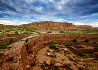 The Great Kiva Of Chetro Ketl Rests Undisturbed As An Ominous Sky Dawns  At Chaco Culture National Historic Park in this commercial landscape photograph by Brian Buckner Photography, Shreveport.