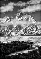 Wispy White Clouds Of Winter Accent The Snow Covered Peak Of The Grand Teton In The Rocky Mountains In This Commercial Black And White Landscape Photograph By Brian Buckner Photography, Shreveport.