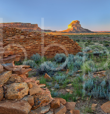 Una Vida Indian Ruins Remain In Shadow At The Edge Of Dawn As Rays Of The Rising Sun Strike Fajada Butte At Chaco Canyon  In This Dramatic Commercial Landscape Photograph By Brian Buckner Photography.
