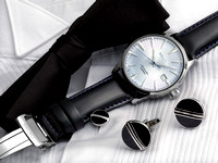 "A SEIKO ""Cocktail Time"" Wristwatch is shown lying on a tuxedo shirt with cuff links and bow tie in this commercial product advertising photograph by Brian Buckner Photography, shreveport."