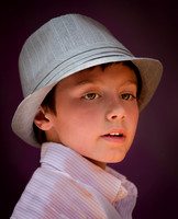 A Young Boy Is Posed Wearing A Hat And Then Photographed Under Very Soft Light in this professional commercial child portrait photograph by Brian Buckner Photography, Shreveport, Louisiana.