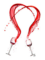 "Two wine glasses filled with wine are thrown upwards creating a heart shaped splash in this commercial product advertising photograph, ""Here's To Love"" by Brian Buckner Photography, Shreveport."